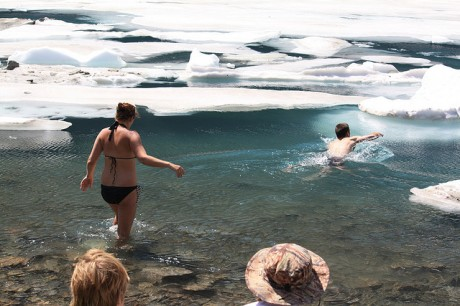 People swimming in Iceberg Lake